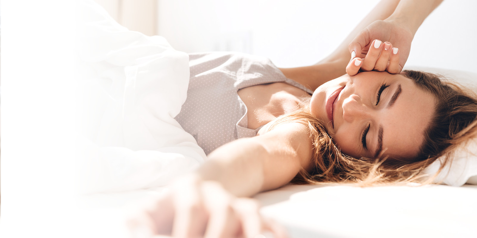 Young woman waking up refreshed in the morning